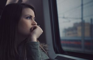 Thinking by window